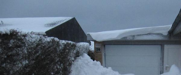 Husejere skal passe på smeltende sne