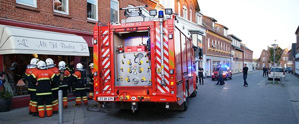 Kortslutning i udstillingslampe udløste brandalarm